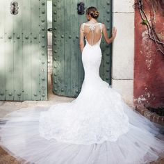 **IN STORE $8,100** CANACE style from 2015 Atelier Pronovias Collection. Sensual and sexy for stunning brides-to-be. An iresistible wedding dress trend.