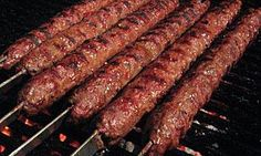 The Adana kebab is a traditional Turkish dish that is eaten throughout Turkey. This article explores this kebab and provides a simple homemade recipe that allows you to make this delicious and tasty Turkish dish. Kabob Recipes, Grilling Recipes, Meat Recipes, Cooking Recipes, Turkish Recipes, Greek Recipes, Indian Food Recipes, Turkish Kebab, Kitchen