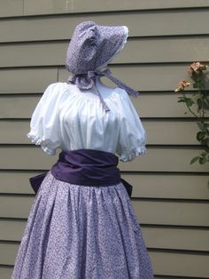 I just finished this charming set. Set includes a full skirt made of a country calico fabric, has a drawstring waist, and a full 120 sweep.