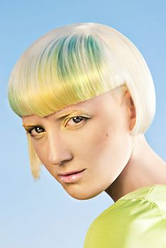 Awesome modern short hair in platinum with gradient bangs from green to yellow. Photography: Marin Sild Photography Hair: Helen Heinroos Make up: Solveig Jõgisoo More Hair Styles Like This!