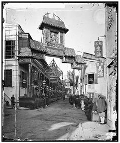 """Historial Hong Kong: """"Through the Lens of John Thomson: Hong Kong and Coastal China, 1868-1872"""" Lyndhurst Terrace  """"Bai Fa Gai"""" in Central is decorated with a triumphal arch in honor of the Duke of Edinburgh's 1869 visit to the colony. The mundane reality of the street was rather different: it was a brothel area so well known it merited a mention in """"Finnegans Wake."""""""
