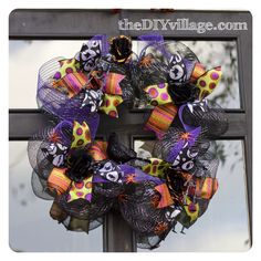 Halloween Wreath with Dollar Store decor by: theDIYvillage.com
