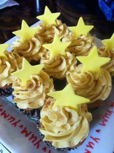 Eggnog cupcakes!  Eggnog cake, rum nutmeg buttercream, nutmeg sprinkled on top, and a fondant star.