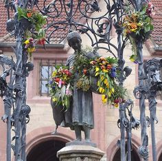 """The most kissed girl in the world: Ganseliesel, Gottingen, Germany.  The tradition in Gottingen says that every graduate from the university kiss the cheeks of the statue after passing their examinations. That s why she is called """"the most kissed girl in the world."""""""