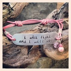 """Love this Handcrafted bracelet. Perfect for that """"Fighter"""" in your life. Gorgeous metallic pink leather with a silver rectangle plate, all hand stamped by me. An added pink czech crystal, and two pink pearl beads. Slip knot for closure. Empower someone with this bracelet today!!!"""