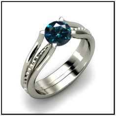 This in yellow or rose gold would be the ultimate in happiness. Blue Diamond Ring