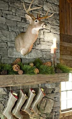 Grey stone fireplace with mantel. I like the pine cone decorations Christmas Lodge, Woodland Christmas, Christmas Mantels, Christmas Decor, Rustic Christmas, Christmas Ideas, Grey Stone Fireplace, Fireplace Mantle, Living Room With Fireplace