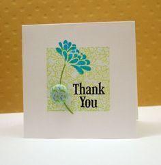 1.Ink up your CLEAN acrylic block with a light colored ink. Experiment with different inks to see what works best for you.  2.Ink up a background stamp. I've used the Hero Arts Lace Background stamp  3.Press the inked lace stamp onto the inked acrylic block.  4.Stamp your impression.  Basic Grey Sweet Threads Thank You stamp set, HA Lace Background Stamp, Acrylic Block, HA Soft Pool Shadow Ink, Ranger Jet Black and Aquamarine Archival Ink, Memento Pear Tart Ink, Basic Gray brad, white…