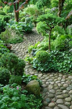 River Rock garden walk offers a rustic path that reminds one of a stream. What if the stones were made in different colors. For more examples of River Rock, visit www.TheMoldStore.us