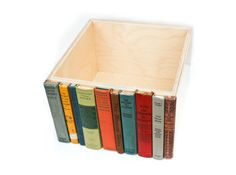 old book spines glued to box, great way to store clutter on a shelf. SHEER BRILLIANCE.