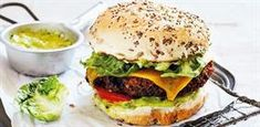 This vegetarian burger is as hearty and as cheesy as the meat version. Lamb Burgers, Salmon Burgers, Topside Beef, Easy Weekday Meals, Vegan Challenge, Burger Buns, Perfect Food, A Food, Food Processor Recipes