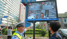 Tech start-ups push to make China's facial recognition systems part of daily life across Asia -- SenseTime, the world's most valuable artificial intelligence start-up, joins Megvii and Yitu Technology in establishing a beachhead for Chinese-developed facial recognition applications in major Southeast Asian markets // A traffic policeman shows a man that he has been identified, through facial recognition, while jaywalking at a street in Shenyang.    SCMP