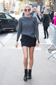 Devon Windsor kept in simple in a gray sweatshirt, black skirt, and ankle boots.