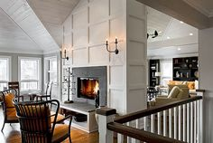 So much to love about this space, starting with that dual-room fireplace