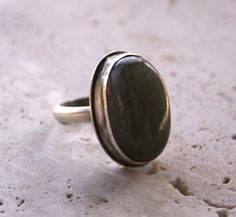Laboradorite stone set in oxidized sterling silver.
