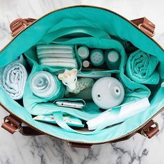 What does it say about me that a picture of a perfectly organized and stocked diaper bag gets me very excited? Wait...don't answer that!