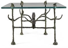 Diego Giacometti,  [1902 - 1985] -  TABLE BASSE TRAPEZOIDALE, MODÈLE AUX HIBOUX ET AUX GRENOUILLES bronze and glass 42.5 by 60 by 55cm.