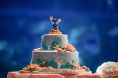 An ocean inspired wedding cake with Stitch to top it all off.