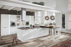 Cucine in legno: design classico contemporaneo Lux Classic | Snaidero.  L'anta telaio di Lux Classic è disponibile in tutta la gamma dei laccati opachi per favorire soluzioni progettali d'ispirazione tradizionale ma con impatto estetico contemporaneo.