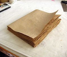 great tutorial to make books out of grocery bags. interesting methodology to get her great paper texture.now to find some paper grocery bags. Book Crafts, Paper Crafts, Diy Paper, Kraft Paper, Recycle Paper, Do It Yourself Ikea, Buch Design, Handmade Books, Handmade Journals