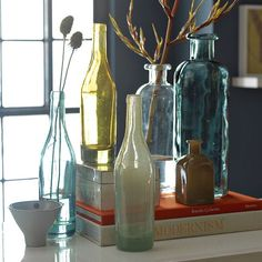 West Elm Recycled-Glass Vases.  I always liked this look (and usually achieve it by using old wine bottles with the labels soaked off).