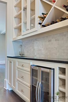 Wet bar with wine fridge and wine storage. Ashford Park Custom Home | Blake Shaw Homes | Atlanta, Athens, Custom Homes and Remodeling