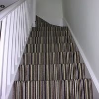 Stripe carpet up stairs