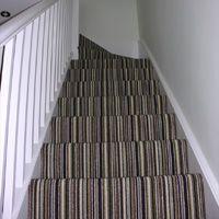 Stripe carpet up stairs