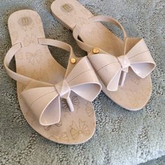 Melissa Flip Flops Super cute Melissa Flip Flops! Bought them thinking I would wear them - but didn't wear them at all. Like new condition. Cute bow on front and bow design on foot. Melissa  Shoes
