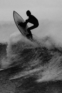 Man on a Surfboard Riding a Wave