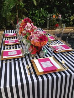 black and white striped linens with gold and pink for a classic style