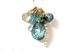 """The essential part of this handmade jewelry design is an eye-catching """"superb"""" faceted Green Quartz stone Beautiful NEW cut  (19mm*14mm), which is accompanied by faceted Champaine Quartz, Green Amethyst, Apatite and Green Pyrite stones. This handmade jewelry composition is accented by green Keshi Pearls and rain-stones."""