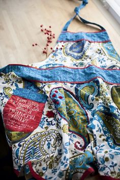 """Paisley apron available at choose2bless.com  Message on red pocket reads, """"From…"""