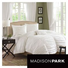Madison Park Catalina White 4-piece Ruched Cotton Comforter Set for $149.99 at overstock.com.  I added this set because it has ruching which adds glamour and it not too feminine.  Ruching is big this year and you can find sets in other colors such as platinum, grey, silver or bright colors.  I try to stay on the gender-neutral side.   My preference is to go all the way girly-girl, but I have a husband.