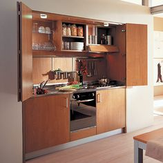 Compact Kitchen Designs For Small Spaces - Everything You Need In One Single Unit For the upstairs teen suites. Micro Kitchen, Hidden Kitchen, Compact Kitchen, Big Kitchen, Kitchen Ideas, Awesome Kitchen, Kitchenette Studio, Studio Kitchen, Luxury Kitchens
