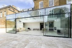 bi-parting maxlight doors, which slide over adjacent fixed panels to create large opening. Building Extension, House Extension Design, Extension Designs, Glass Extension, Glass House Design, Glass House Garden, Modern Glass House, Glass Conservatory, Modern Conservatory