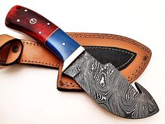 GH-04  Open Length: 7.5 Inches Blade Length: 3.5 Inches Handle Length: 4 Inches Price: $85USD Made of colored camel bone with Mosaic pin