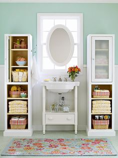 Storing toiletires in separate baskets or containers keeps your bathroom looking neat and tidy.  More bathroom storage ideas: http://www.bhg.com/bathroom/storage/storage-solutions/bathroom-storage-ideas/?socsrc=nhgpin053113floralrug=13