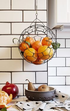 What better inspiration to load up on fruits and veggies than a gorgeous handmade hanging produce basket? Click to see more like this on Etsy's dedicated page of stylish kitchen essentials. #etsyhome
