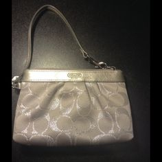 Silver Coach wristlet Like new wristlet. Silver color with full wrist strap Coach Bags Clutches & Wristlets