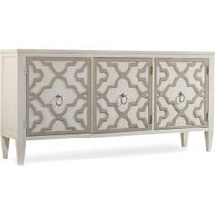 Free Shipping. Shown in Taupe finish.<br/><br/>Two sets of doors, One adjustable shelf behind each door, Ventilated back panel, <br /> Come closer to Melange, and you will discover something unexpected, an eclectic blending of colors, textures and materials in a vibrant collection of one-of-a-kind artistic pieces.