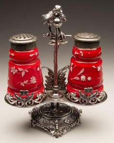 DOUBLE CREASED PAIR OF SALT AND PEPPER SHAKERS, opal cased red with white enamel decorations, matching period two-part lids. Fitted in a figural Bird and Ring quadruple-plate stand marked for the Meriden Britannia Co. and numbered Fourth quarter century. Salt N Peppa, Vintage Glassware, Vintage Dishes, Vintage Pyrex, Vintage Tea, Pepper Spice, Red Cottage, Plate Stands, Salt And Pepper Set