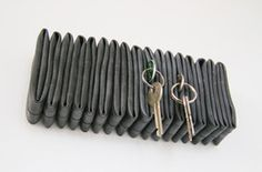 PJOO Petra Jäger Objekte // Cyczak // home accessory made of folded inner tubes # Recycling, Diy Recycle, Fire Hose Crafts, Key Organizer, Bicycle Parts, Recycled Rubber, Office Accessories, Etsy, Projects