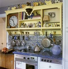 Betsy Speert's Blog: December 2011 | Vintage country kitchen. Yellow cabinets, blue and white
