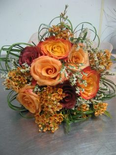 Beautiful orange and red rose bouquet by our inhouse floral designer! See more of her work at facebook.com/flowersbythewestwood #fall #wedding #bouquet #flowers