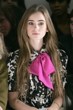 Lilly Collins front row, love her printed blouse