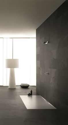 Unique The new enamelled shower surface with its integrated wall outlet blends perfectly with the bathroom floor