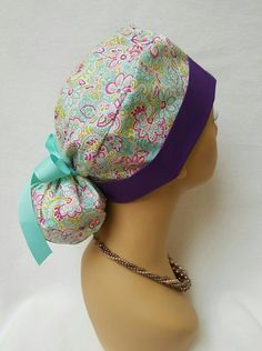 Check out this item in my Etsy shop https://www.etsy.com/listing/470189920/ponytail-scrub-hat-with-ribbon-scrub-hat