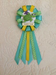 A personal favorite from my Etsy shop https://www.etsy.com/listing/504625757/mommy-to-be-ribbon-corsage-for-baby