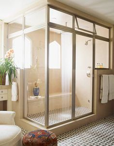 The steam shower enclosure in this Peter Dunham-designed bathroom is by Met-Tec. via HouseBeautiful...want the door and transom but I'll pass on feeling like I'm taking a shower in a greenhouse;-)